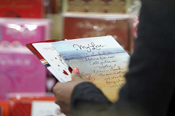 A woman chooses a card for the Valentine's Day in Kathmandu.