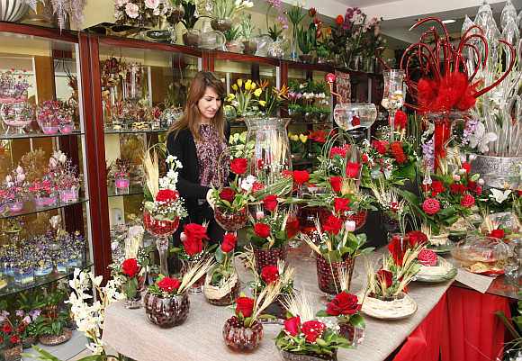 A woman waits to buy flowers on Valentine's Day in Amman, Jordan.