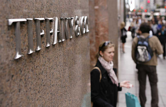 A woman walks out of the Tiffany store on Fifth Avenue in New York.