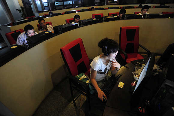People use computers at an Internet cafe in Hefei, Anhui province, China.
