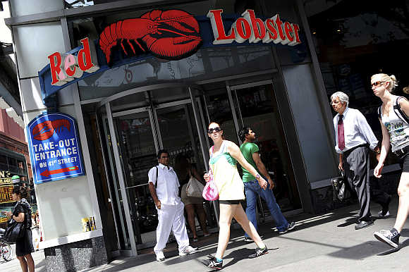 Passersby walk in front of the Times Square Red Lobster restaurant in New York.