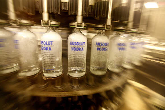 Empty bottles are washed on a production line at the Absolut bottling facility in Ahus, Sweden.