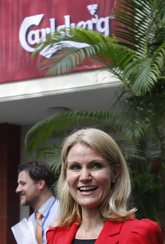 Denmark's Prime Minister Helle Thorning-Schmidt visits Hanoi Beer Factory, which produces Danish beer Carlsberg.