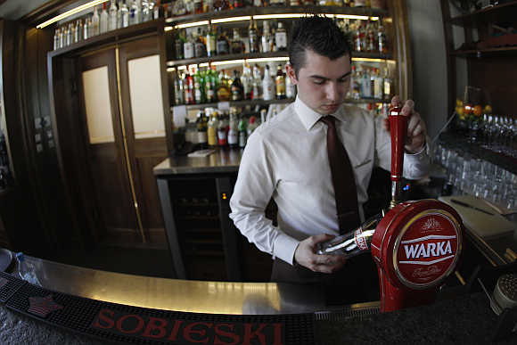 A bartender pours beer at the Sielanka nad Pilica Hotel in Warka, Poland.