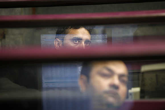 Brokers monitor the market at the Karachi Stock Exchange.