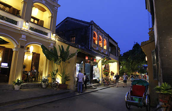 Tourists visit Vietnam's central ancient town of Hoi An, a Unesco world heritage site.