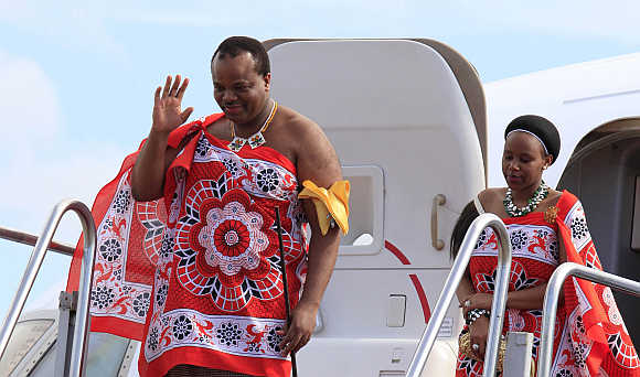 King of Swaziland Mswati III and his wife disembark a plane after arriving at Katunayake International airport in Colombo, Sri Lanka.