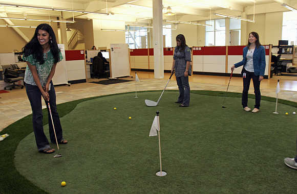 Employees play on the putting green at the YouTube headquarters in San Bruno, California.
