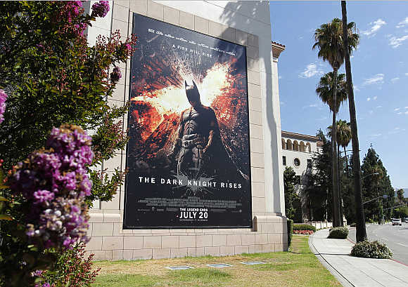 A poster for the Warner Bros. film 'The Dark Knight Rises' is displayed at Warner Bros. studios in Burbank, California.