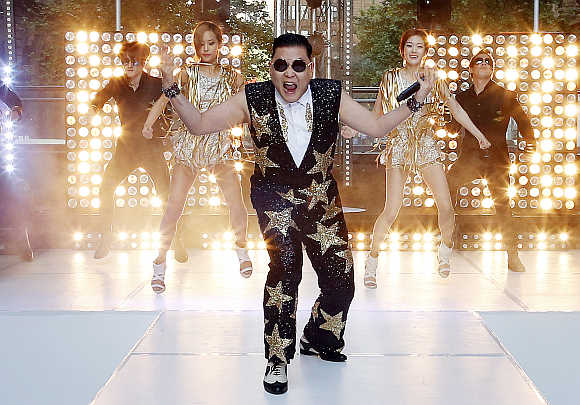 South Korean singer Psy performs his hit 'Gangnam Style' in central Sydney, Australia.