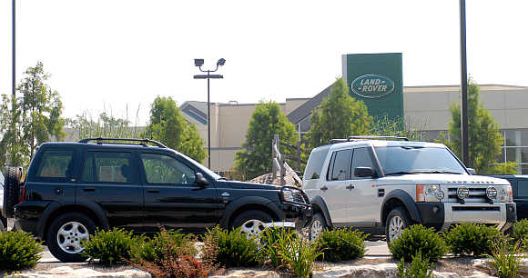 Range Rover SUV's at a Jaguar and Land Rover car dealership in Louisville, Kentucky.