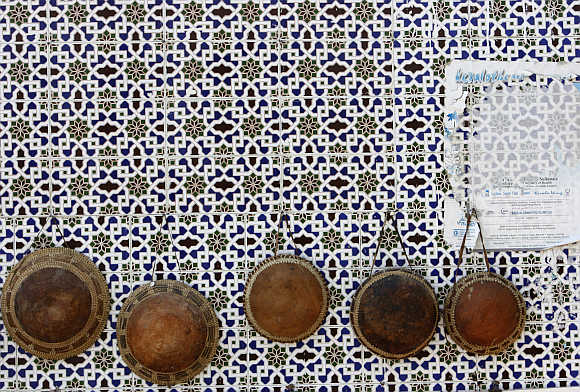 Hats are displayed on a wall in Mattrah Souq, the oldest market in Oman, in the capital Muscat.