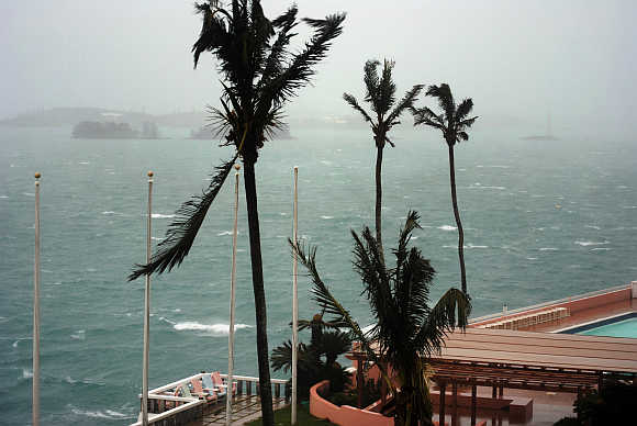 High winds and rising surf come ashore in Hamilton, Bermuda.