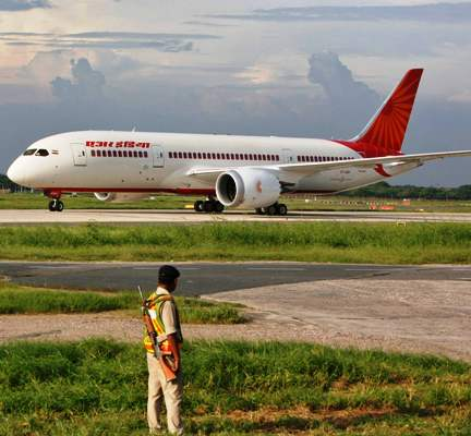 A security personnel stands guard as Air India's Dreamliner Boeing 787 taxies upon its arrival at the airport in New Delhi.