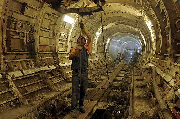 Workers carry out works in the underground deep drainage tunnel system in Mexico City.