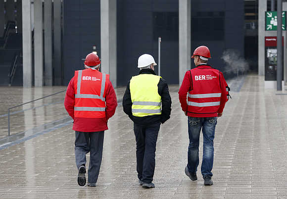 Workers at the construction site of the Berlin Brandenburg International Airport Willy Brandt in Schoenefeld, Berlin.