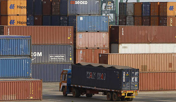 A truck ferries a shipping container at a port in Chennai.