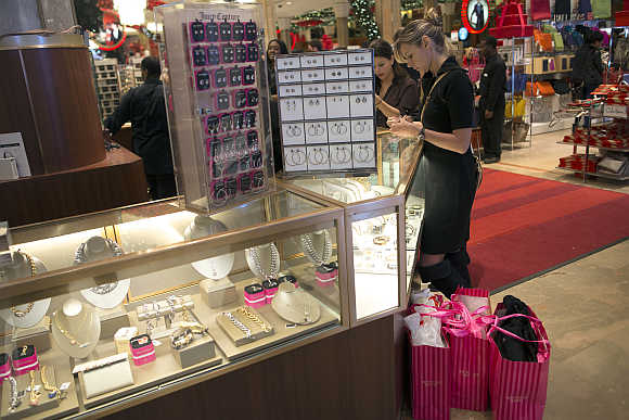 Shoppers look over items at a Macy's store in New York.