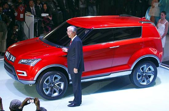 Shinzo Nakanishi, chief executive and MD of Maruti Suzuki poses with company's new compact SUV XA Alpha car.