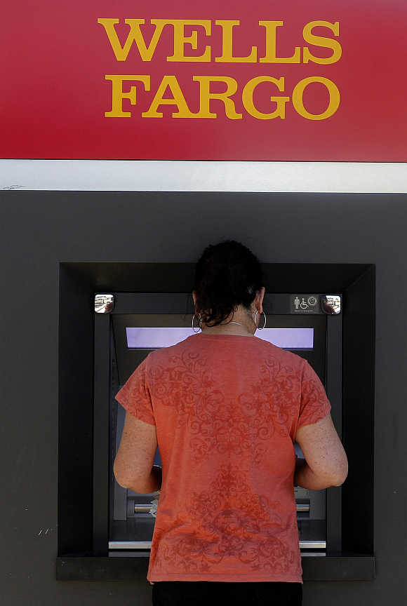 A customer uses an ATM machine at a Wells Fargo bank in Los Angeles, Calfornia.