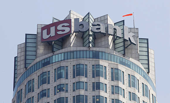 The logo of US Bank is seen atop the US Bank Tower in downtown Los Angeles.