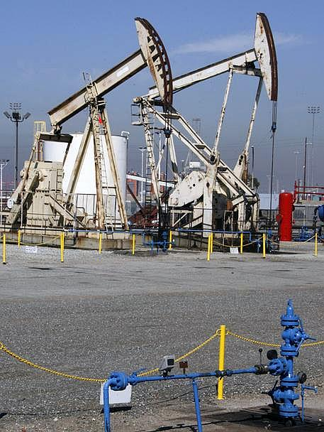 Oil is pumped from wells at the Port of Long Beach, California.