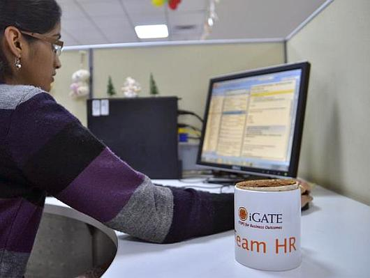 An employee works at the headquarters of iGate in Bangalore.