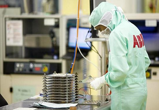 An employee works on the production of high-power semiconductors at