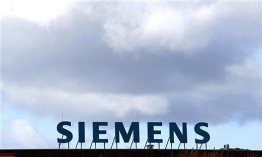 The logo of Siemens AG company is pictured atop a factory in Berlin.