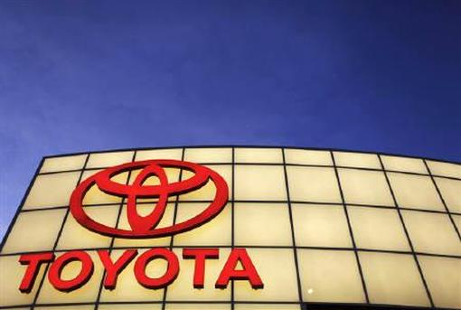 The Toyota logo is lit up above Boch Toyota's dealership in Norwood, Massachusetts.