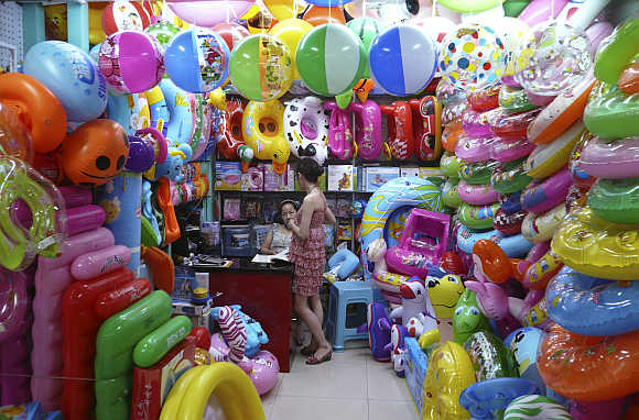 Vendors sell toy buoys at a market in Yiwu, Zhejiang province, China.