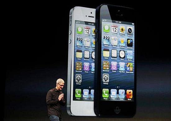 Apple Inc. CEO Tim Cook takes the stage after the introduction of the iPhone 5.