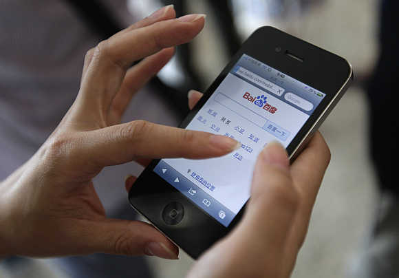 A user loads the Baidu homepage on her Apple iPhone 4 in Beijing.