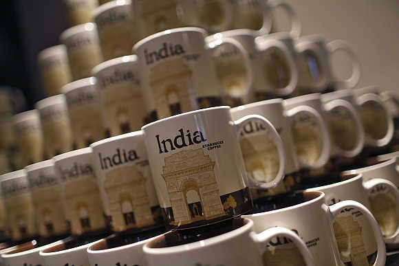 Coffee mugs featuring the India Gate war memorial are on display during the launch of the first Starbucks store in New Delhi.