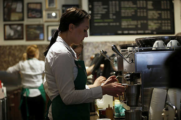 A barista prepares coffee at Starbucks.
