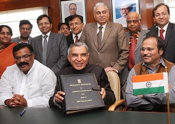 Railway Minister Pawan Kumar Bansal giving finishing touches to the documents of Railway Budget 2013-14.