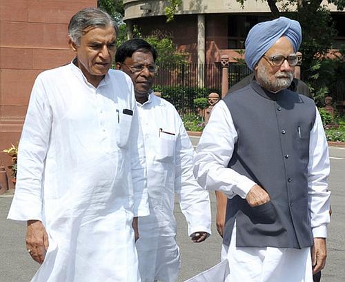 Prime Minister Manmohan Singh with Railway Minister Pawan Kumar Bansal.