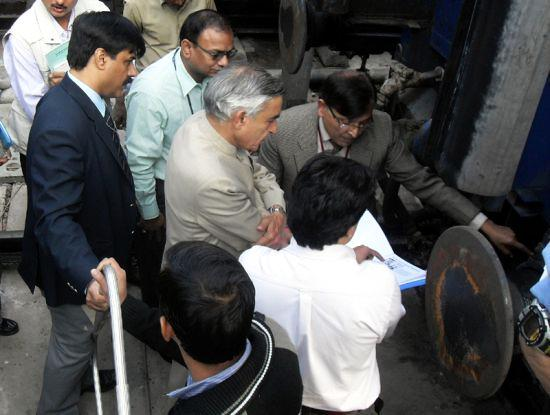 Pawan Kumar Bansal visits the New Delhi Railway station to see implementation of a new project.
