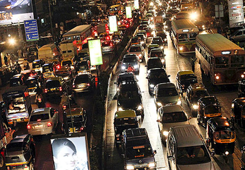 Vehicles are seen in a traffic jam during rush hour in Mumbai.
