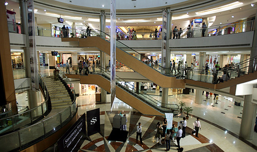 People stroll in Inorbit mall in Mumbai.