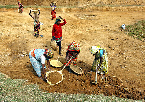 Village women work at a road construction site under the National Rural Employment Guarantee Act.