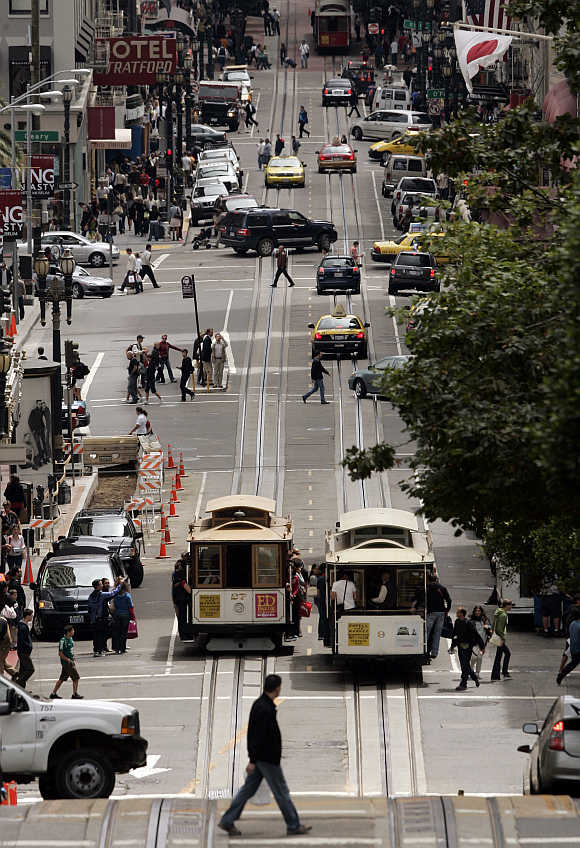 Cable cars pass each other along Powell Street in San Francisco, California.