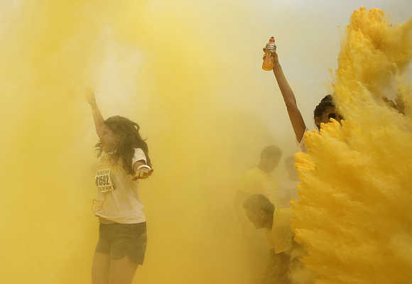 Participants are hit by coloured powder during the 'The Color Run' in Rio de Janeiro.