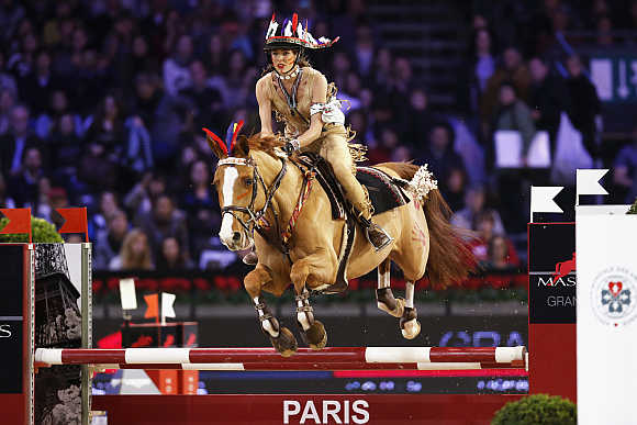 Charlotte Casiraghi, second child of Caroline, Princess of Hanover, participates in the Gucci Paris Masters International Jumping competition in Villepinte near Paris.