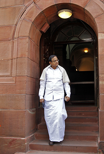 Palaniappan Chidambaram comes out of the parliament after attending the first day of the budget session.