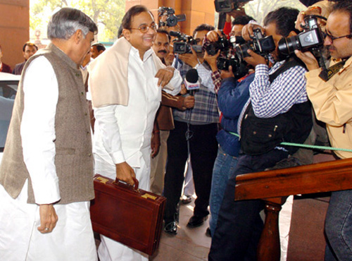 Finance Minister Palaniappan Chidambaram holds the economic survey 2012-13 report.