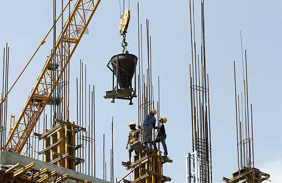 Labourers work at the construction site of a commercial complex in Chennai.