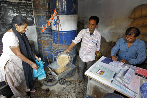 A woman who holds a BPL (Below Poverty Line) card buys wheat from a government-run ration shop in Ahmedabad.