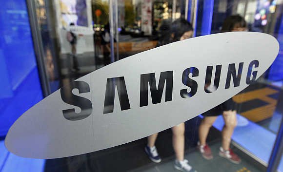 Students walk out of a showroom at the headquarters of Samsung Electronics in Seoul.