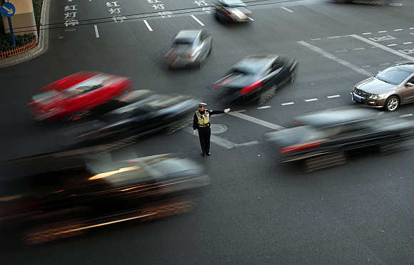 A policeman directs traffic in Shanghai.